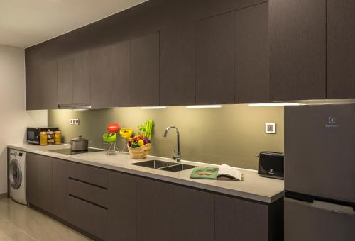 A kitchen or kitchenette at Citadines Blue Cove Danang