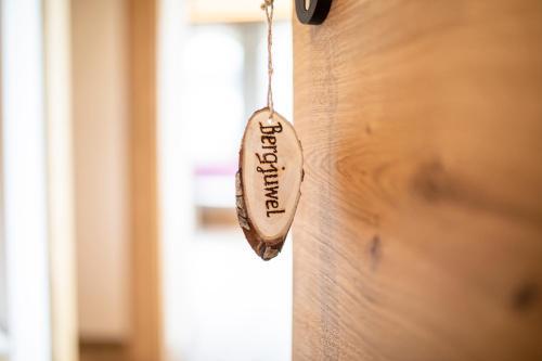 Ein Zertifikat, Auszeichnung, Logo oder anderes Dokument, das in der Unterkunft Apartment Bergjuwel ausgestellt ist