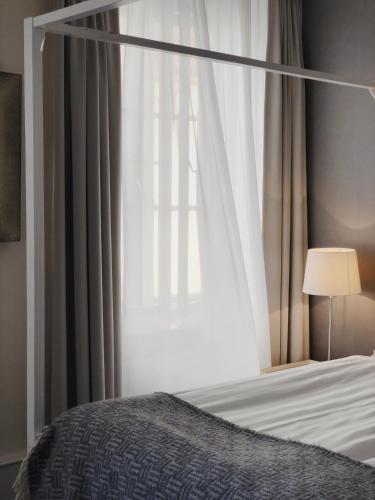 Lova arba lovos apgyvendinimo įstaigoje Kalk Hotel