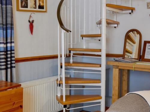 A bunk bed or bunk beds in a room at Pebbles