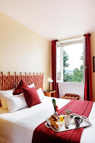 Un ou plusieurs lits dans un hébergement de l'établissement Hôtel La Petite Verrerie