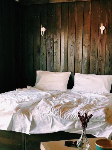 Ein Bett oder Betten in einem Zimmer der Unterkunft Olkhon Story guesthouse