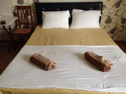 A bed or beds in a room at Kobaladze Apartments