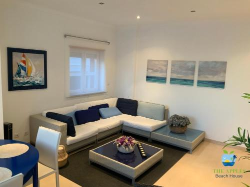 A seating area at The Apples - Beach House