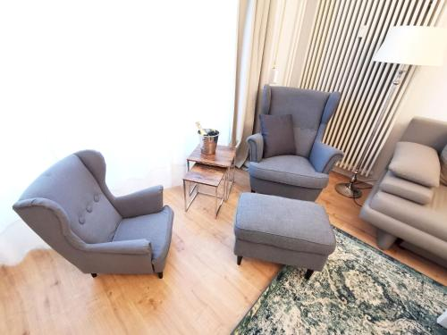 """A seating area at Lovely-Flats """"Kamminer VH"""""""
