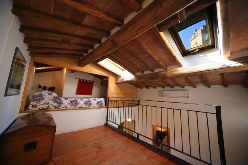 A balcony or terrace at Fabio Apartments San Gimignano