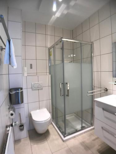 Ein Badezimmer in der Unterkunft Aramis Studio Hotel