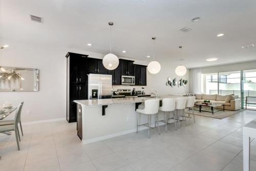 A kitchen or kitchenette at New, Orlando Newest Resort Community Town Home Townhouse