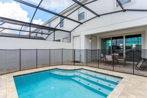 The swimming pool at or close to New, Orlando Newest Resort Community Town Home Townhouse