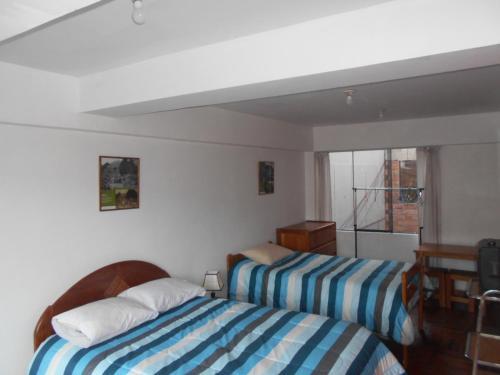 Cama o camas de una habitación en Hospedaje Familia Hanacpacha