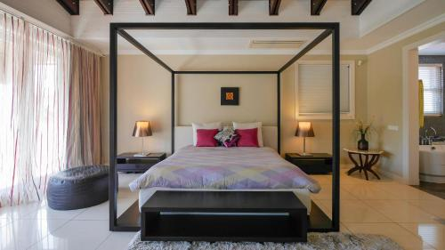 A bed or beds in a room at Villa Constantine, self-catering luxury beach house