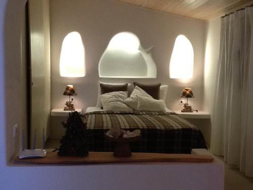 Een bed of bedden in een kamer bij Blue Horizon