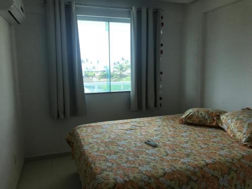 A bed or beds in a room at Apartamento Praia Dos Milionários