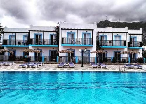 The swimming pool at or close to Sweet Kalimera Apartments