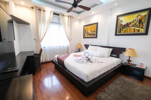 Giường trong phòng chung tại Le Domaine de Cocodo