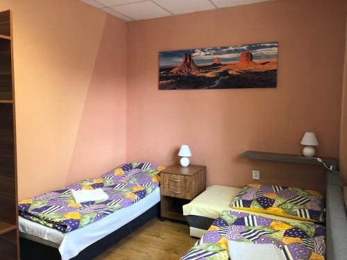 A bed or beds in a room at Ubytovanie Poprad