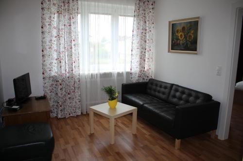 Ein Sitzbereich in der Unterkunft Apartment Abl