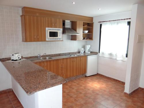 A cozinha ou cozinha compacta de Apartamentos Lanzarote Paradise