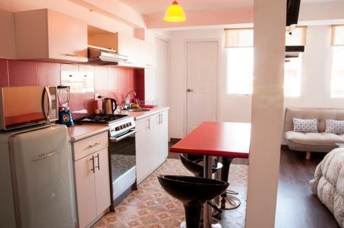 Una cocina o zona de cocina en Terra Nostra Suites