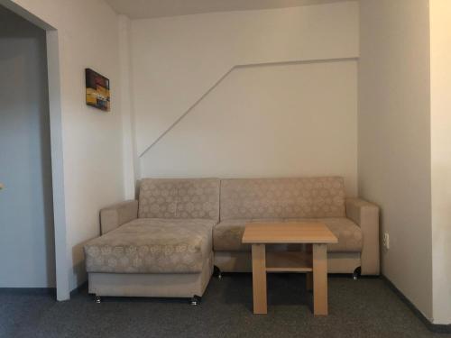 Svetainės erdvė apgyvendinimo įstaigoje Apartment Pulse Fitness