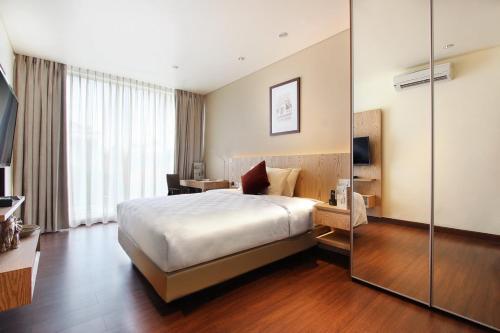 Tempat tidur dalam kamar di Dwijaya House of Pakubuwono