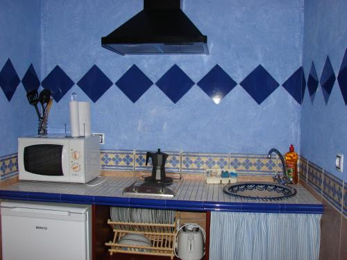 A kitchen or kitchenette at Cortijo los Llanos
