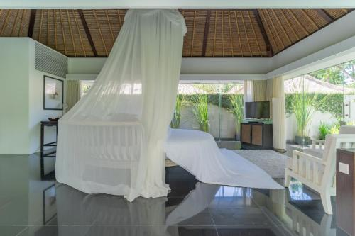 A bed or beds in a room at Kayumanis Nusa Dua Private Villa & Spa