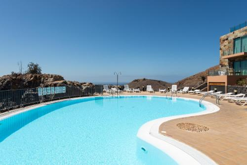 The swimming pool at or close to VILLA LAGOS - GRAN CANARIA STAYS