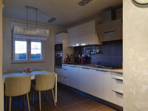 "A kitchen or kitchenette at ""Monte paradiso"""
