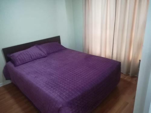 Cama o camas de una habitación en Depto Metro Irarrazaval
