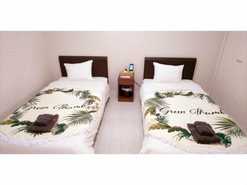 かりゆしコンドミニアムリゾート名護 RB villaにあるベッド