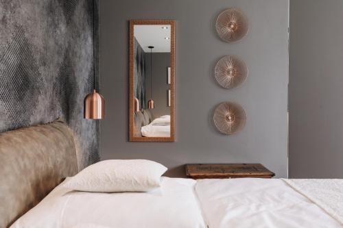 Postel nebo postele na pokoji v ubytování VILLA BRICOLA - Boutique Apartments