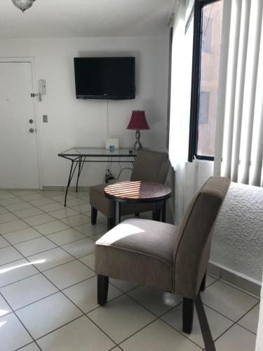 A television and/or entertainment center at ELEGANT CONDO LOCATED IN ZONA RIO MOST EXCLUSIVE AREA OF TIJUANA CORNER OF PASEO DE LOS HEROES MAIN BOULEVARD OF TIJUANA VERY ELEGANT AND SECURE GATED ENTRANCE CLOSE TO SHOPPING MALLS AND THE BEST RESTAURANTS