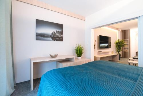A bed or beds in a room at Pod Hrebienkom Apartment C218