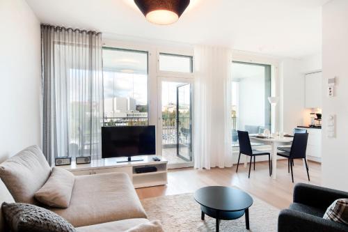 Area tempat duduk di Apartment Hotel Aallonkoti