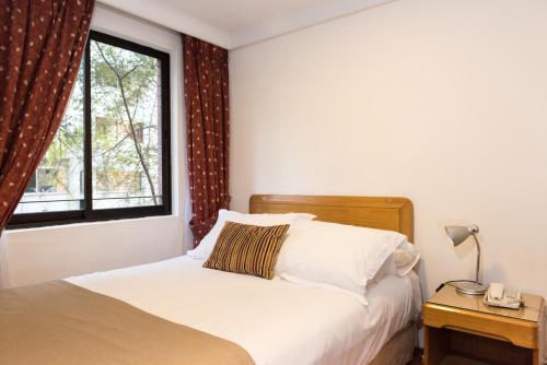 Cama o camas de una habitación en Presidente Edificio Santiago