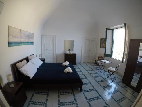 A bed or beds in a room at Villa La Mura