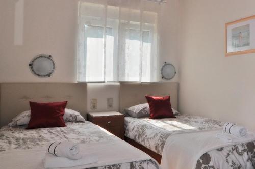 Postelja oz. postelje v sobi nastanitve Villa Vanilla
