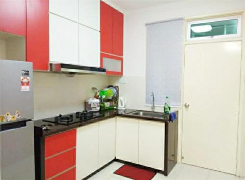 A kitchen or kitchenette at SPICE ARENA HOMESTAY