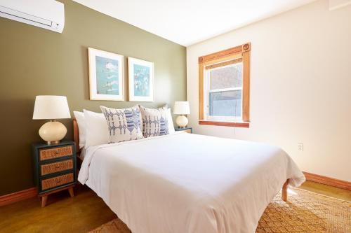 A bed or beds in a room at Sonder — East Village Bungalows
