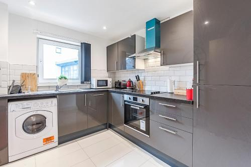 A kitchen or kitchenette at Venus Terrace Apartment