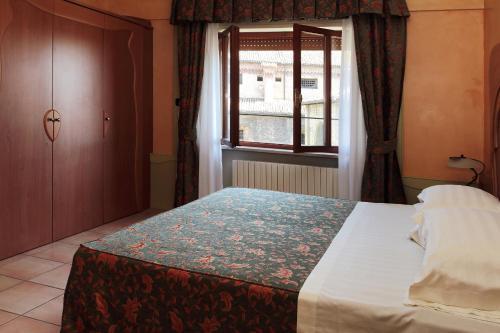 Letto o letti in una camera di Residence Liberty