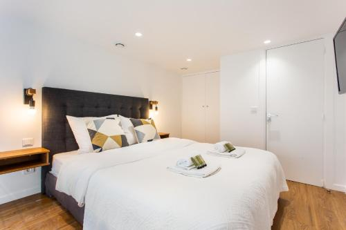 A bed or beds in a room at Dreamyflat residence