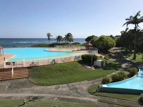 The swimming pool at or near Domaine de l'Anse des Rochers