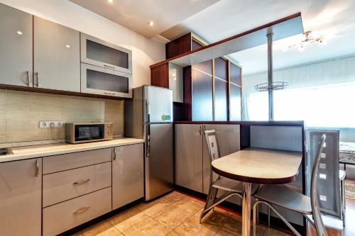 A kitchen or kitchenette at Apartments on Dostyk 5