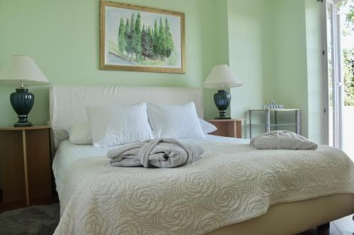 A bed or beds in a room at Villa Tereza