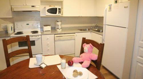 A kitchen or kitchenette at Times Square Suites