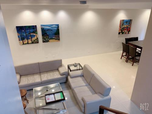A seating area at Tumon Bel-Air Serviced Residence