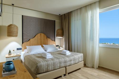 A bed or beds in a room at Marni Village