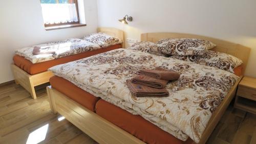 Postel nebo postele na pokoji v ubytování Club Rezidence Pod Lučí